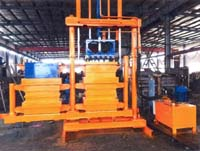 Twin chamber textile baler